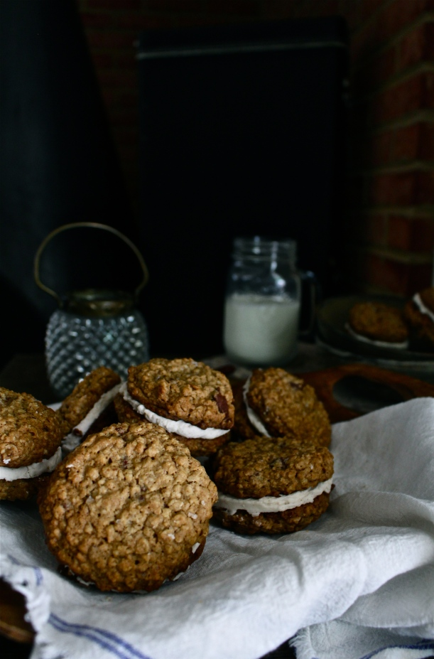 Chocolate Chunk Oatmeal Cream Pies with Cinnamon Cream & Sea Salt