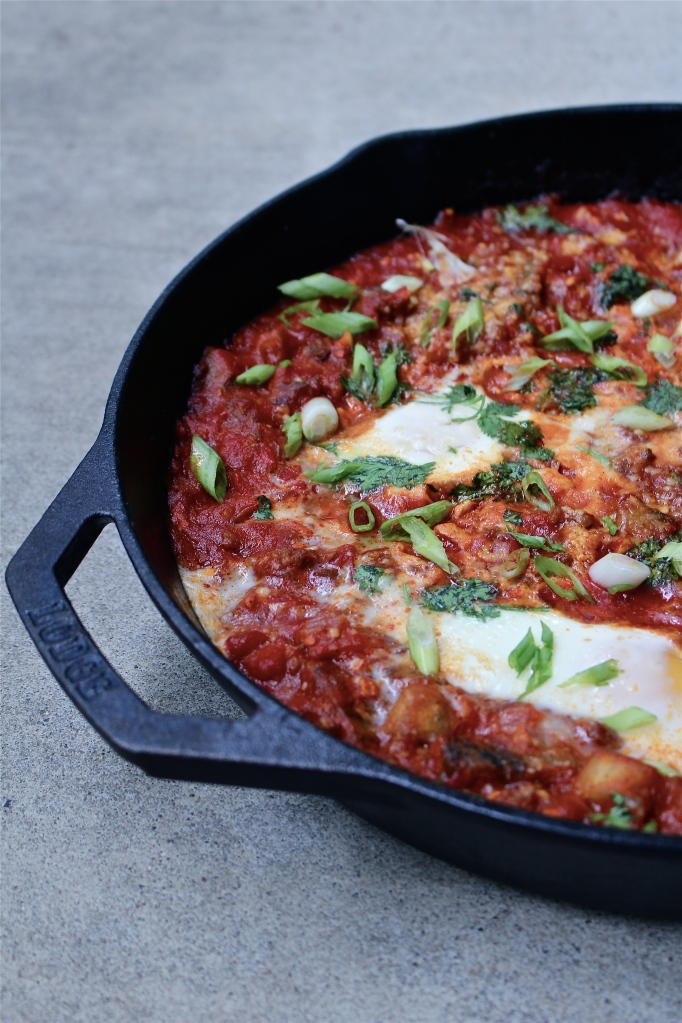 Moroccan Baked Eggs with Merguez, Eggplant and Harissa