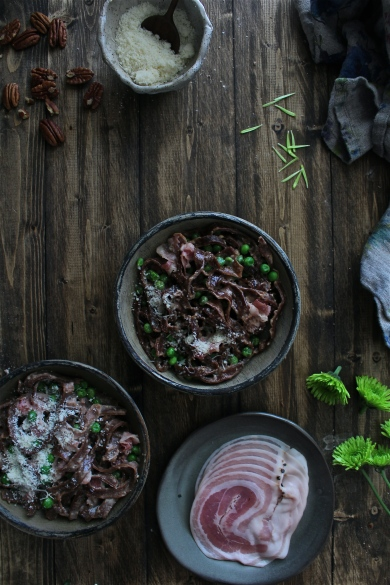 https://harvestandhoney.com/2016/03/23/homemade-chocolate-pasta-with-pancetta-sweet-peas-a-creamy-toasted-pecan-sauce/