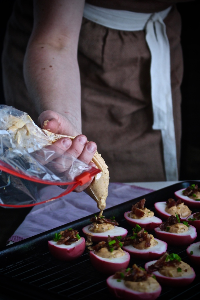 Smoky Tomato Deviled Eggs with Candied Bacon